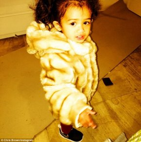 'Care Bear!' The 26-year-old Grammy winner's 18-month-old princess was bundled up in a £208 Childsplay Clothing 'Microbe' faux fur coat featuring a detachable hood